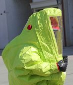 stock photo of asbestos  - person with yellow protective suit to work in presence of asbestos - JPG