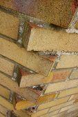 foto of interlocking  - Interlocking bricks at corner where two walls intersect - JPG