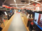 picture of distort  - Defocused and blur image of a shop selling household appliances with wide angle distortion view was blurred for use as a background - JPG