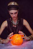 picture of fortune-teller  - Fortune teller forecasting the future on black background - JPG