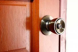 stock photo of safety barrier  - Photo of a door lock and door knob - JPG