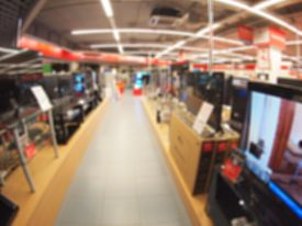 image of distort  - Defocused and blur image of a shop selling household appliances with wide angle distortion view was blurred for use as a background - JPG