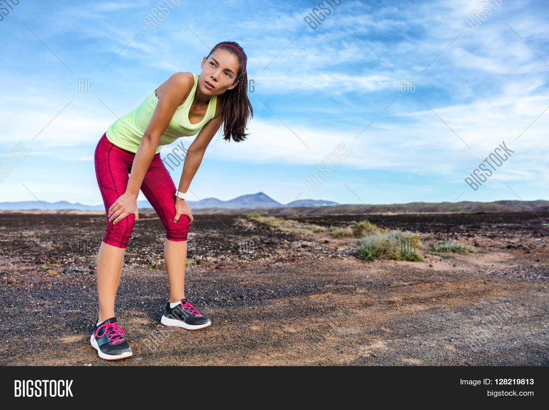 Trail runner taking a running break breathing tired ...