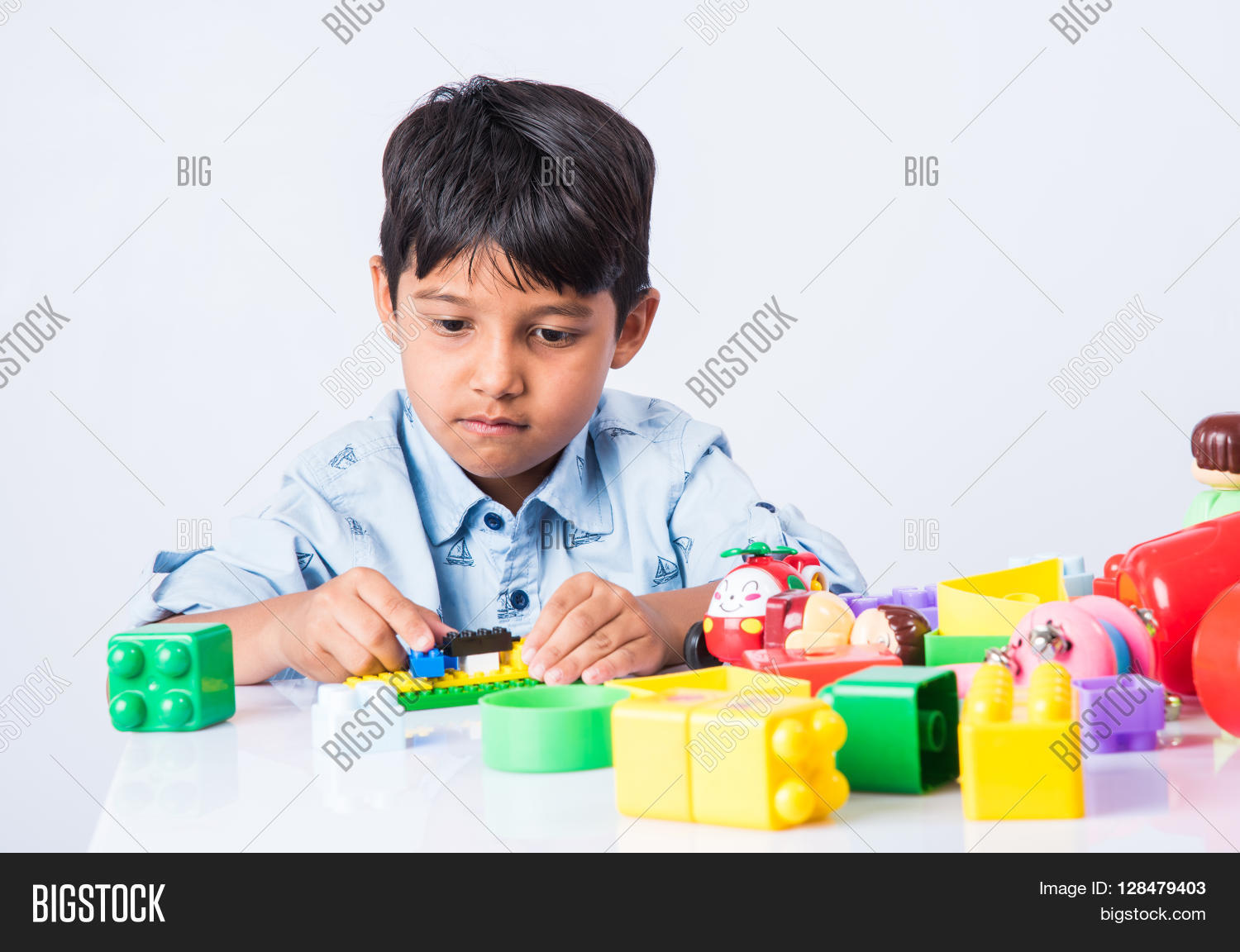 Big Boy Toys Games : Indian kid playing block toys image photo bigstock