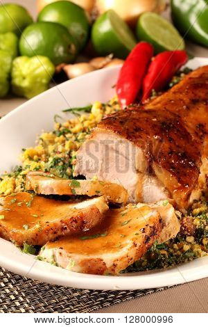 A Juicy Fresh Pork Loin Roast Sliced On A Plate