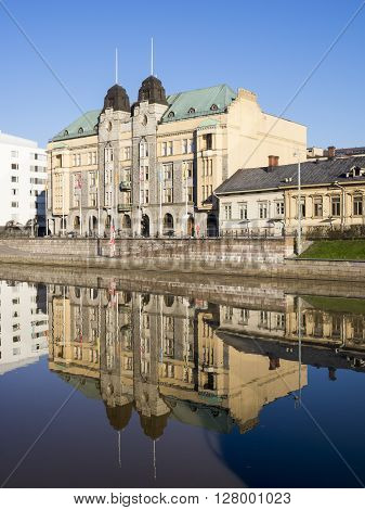 TURKU, FINLAND - APRIL 30: Buildings by the River Aurajoki in Turku, Finland at April 30, 2016