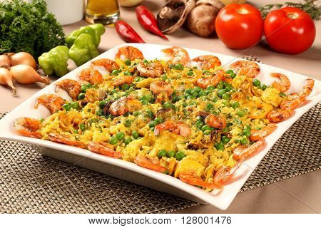 Spanish Dish Paella With Seafood, Shrimps, Squid, Rice, Saffron, Traditional Plate.