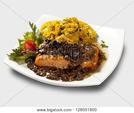 Salmon with mushroom and pasta. White background.