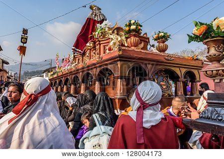 Antigua Guatemala - March 24 2016: Local men & women take part in Holy Thursday procession with float of Virgin Mary in colonial town with most famous Holy Week celebrations in Latin America.