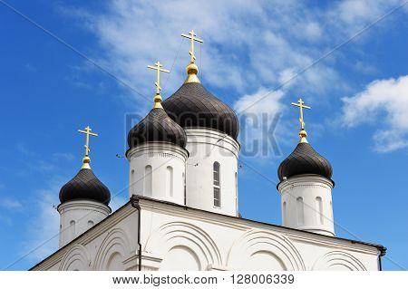 Orthodox church. Domes of Uspenskiy monastery in blue sky
