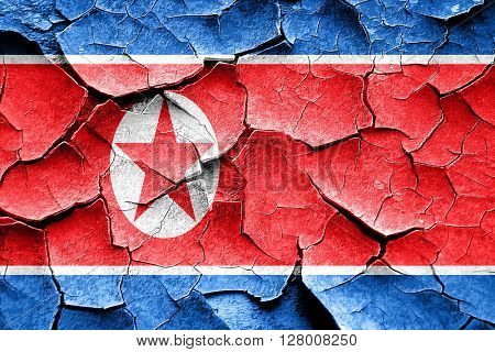 Grunge North Korea flag with some cracks and vintage look