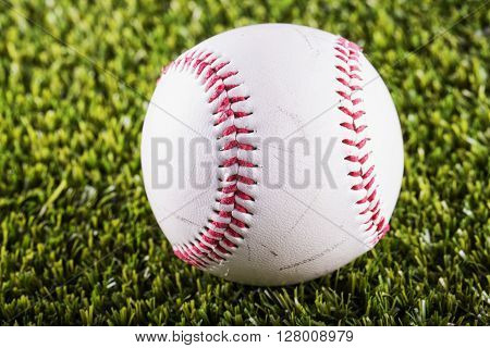 Baseball over green grass close up horizontal image