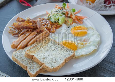 Breakfast With Bread Fried Egg And Sausage