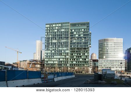 BOSTON, MASSACHUSETTS/USA - APRIL 14, 2016: Window washers making quick work of cleaning glass on Boston office building