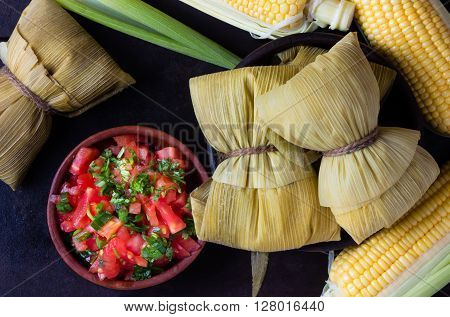 Latin American food. Traditional homemade humitas of corn. Top view