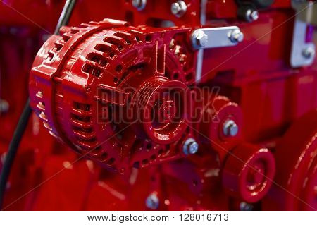 Detail of red powerful engine, diesel motor for oversize trucks, SUV, cargo, commercial and construction vehicles, heavy industry, selective focus