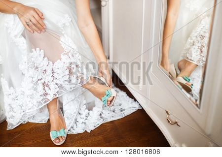 Bride's shoes on wedding day. Morning bride. Getting ready