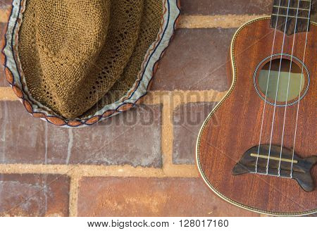 Guitar And Hat Decoration On Brick Wall
