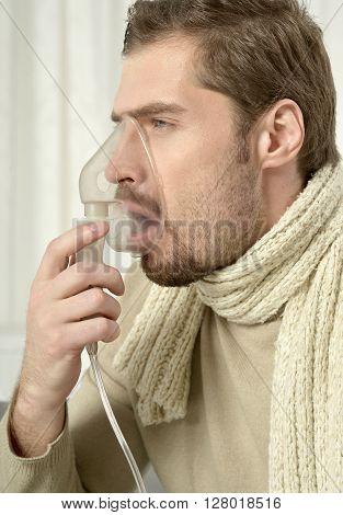 Portrait Of Man Inhaling Through Inhaler Mask