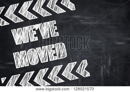 Chalkboard writing: We've moved sign
