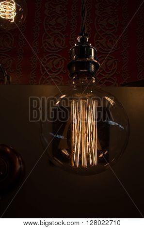 Vintage incandescent Edison type light bulb in interior