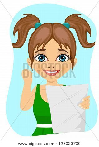 happy little girl exults pumping fists ecstatic celebrates holding paper with result at college on blue background