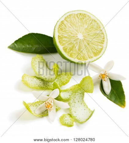 Half of lime fruit blossom and zest isolated on white background. Selective focus on the flower.