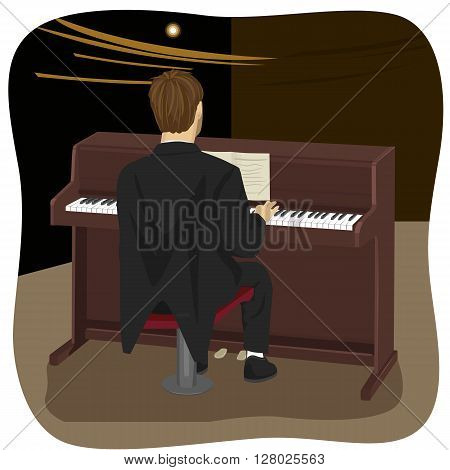 back view of young man playing brown upright piano in concert hall