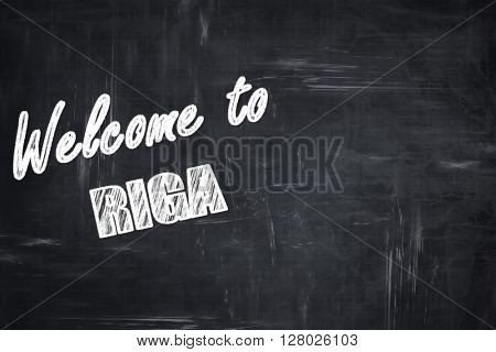 Chalkboard background with chalk letters: Welcome to riga