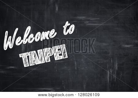 Chalkboard background with chalk letters: Welcome to taipei