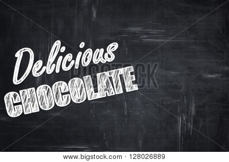 Chalkboard background with chalk letters: Delicious chocolate si