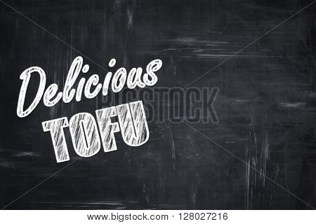 Chalkboard background with chalk letters: Delicious tofu sign