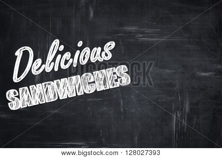 Chalkboard background with chalk letters: Delicious sandwich sig