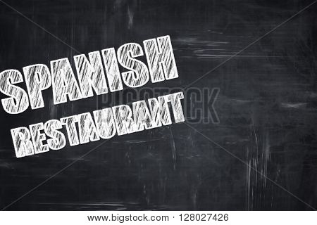 Chalkboard background with chalk letters: Delicious spanish cuis