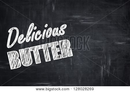 Chalkboard background with chalk letters: Delicious butter sign