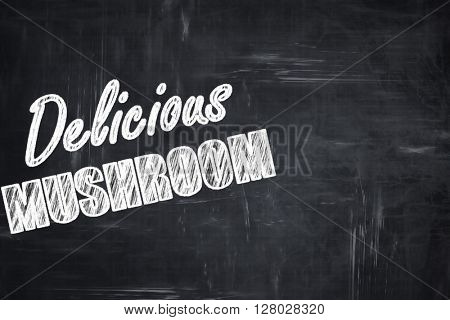 Chalkboard background with chalk letters: Delicious mushroom sig