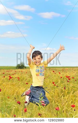 happy boy jumping on field