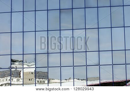 reflected in a city building resembling a sea ship