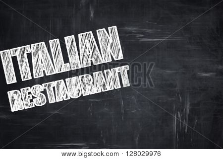 Chalkboard background with chalk letters: Delicious italian cuis