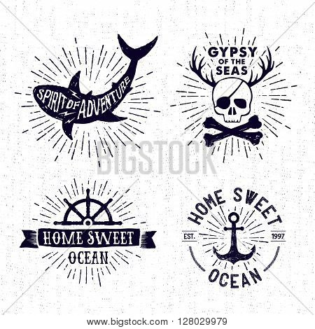 Hand drawn textured vintage badges set with shark pirate skull steering wheel anchor and inspirational lettering.