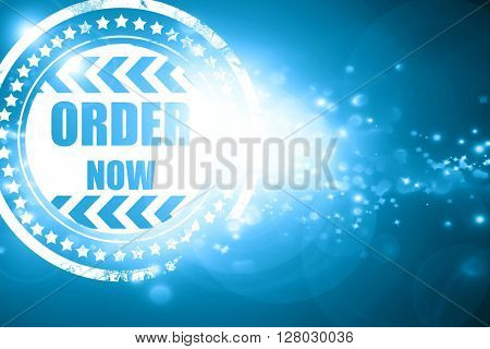 Blue stamp on a glittering background: Order now sign