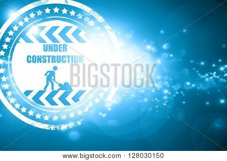 Blue stamp on a glittering background: Under construction sign