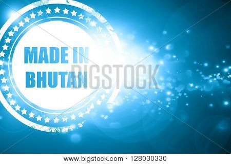 Blue stamp on a glittering background: Made in bhutan