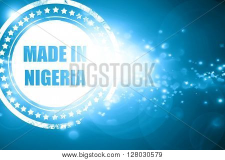 Blue stamp on a glittering background: Made in nigeria