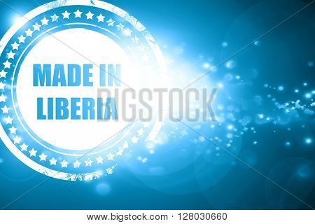 Blue stamp on a glittering background: Made in liberia