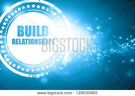 Blue stamp on a glittering background: build relationships
