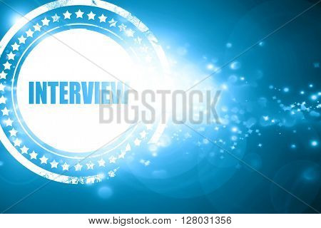 Blue stamp on a glittering background: interview