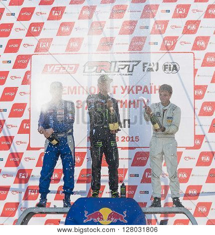 Lviv Ukraine - June 7 2015: Awarding ceremony of the first stage of the Ukrainian championship Drift 1st Dmytro ILLYUK 2nd Alexey Golovnya 3rd Volodymyr Borovitski near Arena - Lviv stadium.