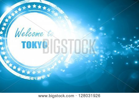Blue stamp on a glittering background: Welcome to tokyo