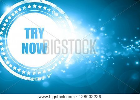 Blue stamp on a glittering background: try now sign